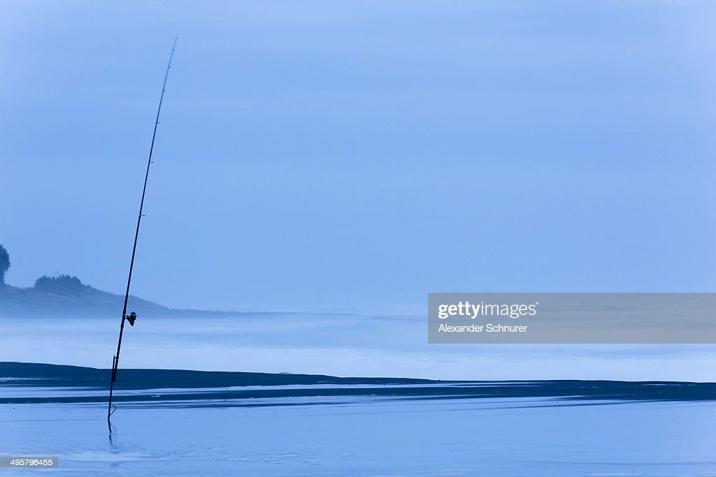 Fishing rod on the beach at dusk, Oakura, Taranaki Region, New Zealand