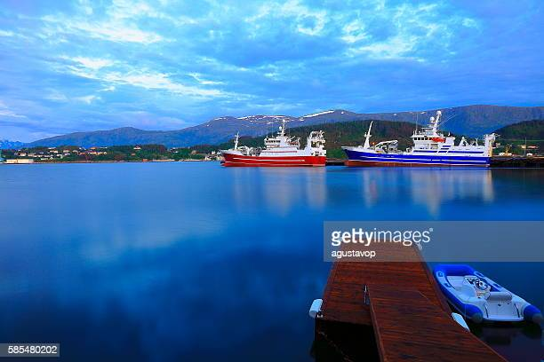 Fishing ships,  Alesund harbor long exposure evening panorama, Norway, Scandinavia