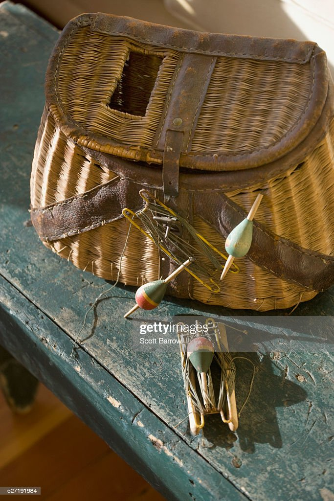 Fishing tackle and a basket : Foto stock