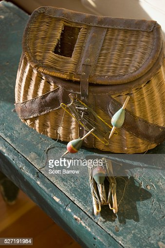 Fishing tackle and a basket : Stock Photo