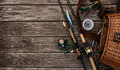 Fishing accessories on the wooden table. Elements for advertising