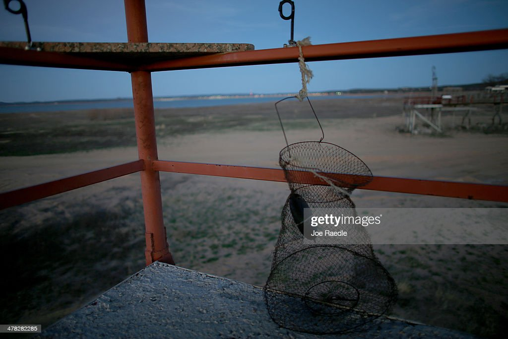 A fishing trap is seen attached to the end of a pier once surrounded by the water of Lake Buchanan before a severe drought on March 12, 2014 in Burnet, Texas. Farmers down stream and people living on the lakes are trying to figure out the best way to deal with the drought and water control. Recently the Texas Commission on Environmental Quality agreed to cut off water deliveries to most rice farmers in the Lower Colorado River Basin for the third straight year as the lakes in central Texas are only 38 percent full.