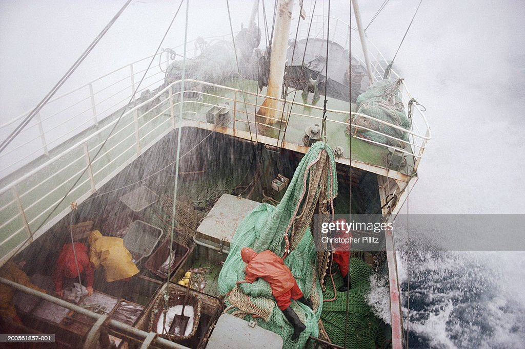 Fishing trawler at sea during storm : Stock Photo
