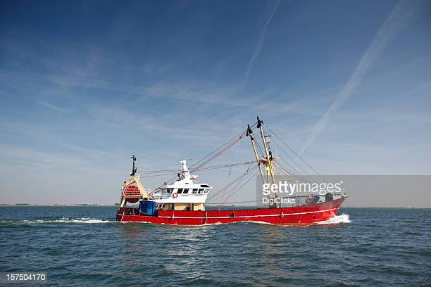 A fishing trawler cruising in the sea