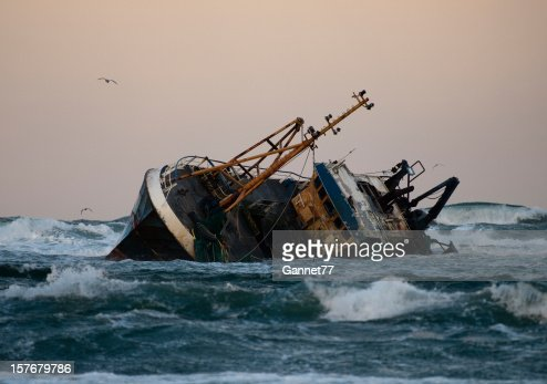 Fishing vessel boat aground on sea