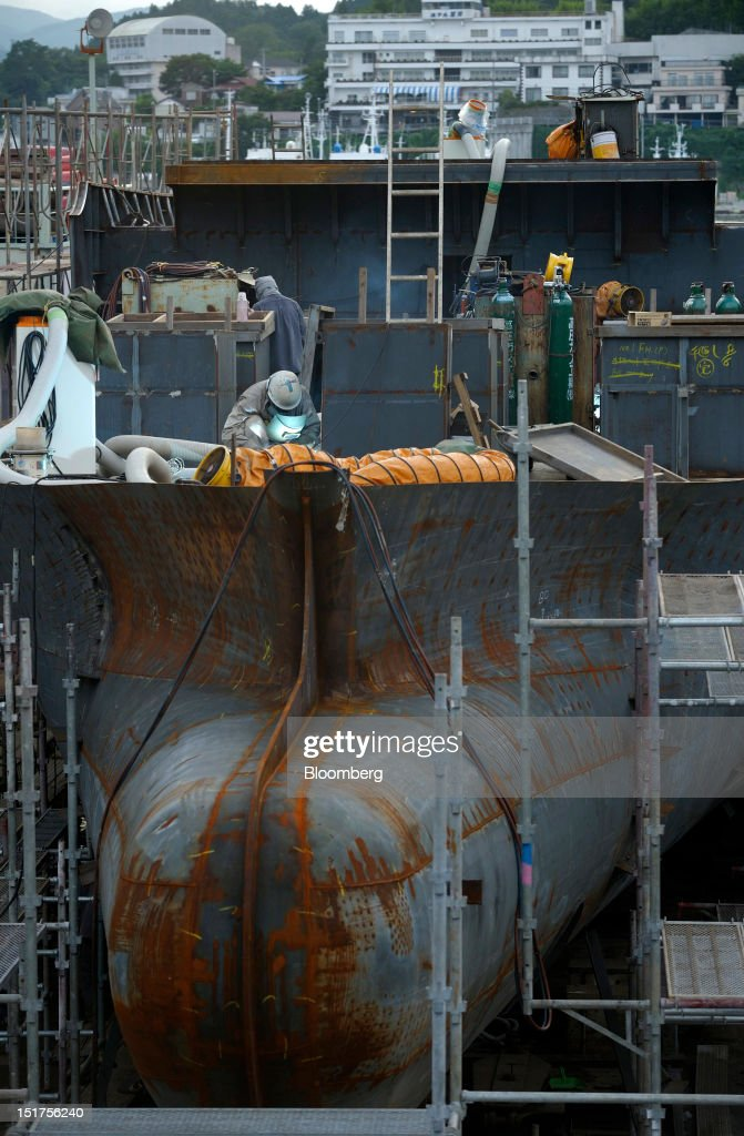 A fishing vessel stands under construction at a shipyard in Kesennuma City, Miyagi Prefecture, Japan, on Thursday, Sept. 6, 2012. Japan's economy expanded in the second quarter at half the pace the government initially estimated, underscoring the risk of a contraction as Europe's debt crisis caps exports. Photographer: Akio Kon/Bloomberg via Getty Images