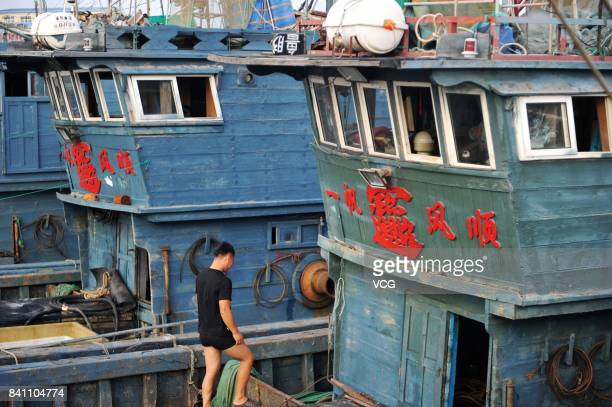 Fishing vessels are ready to set sail at a fishing port on August 30 2017 in Qingdao Shandong Province of China Fishing ban started from May 1 on...