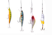 four fishing wobblers isolated on white background