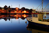 Fishing-boat in harbour by night, Sweden.