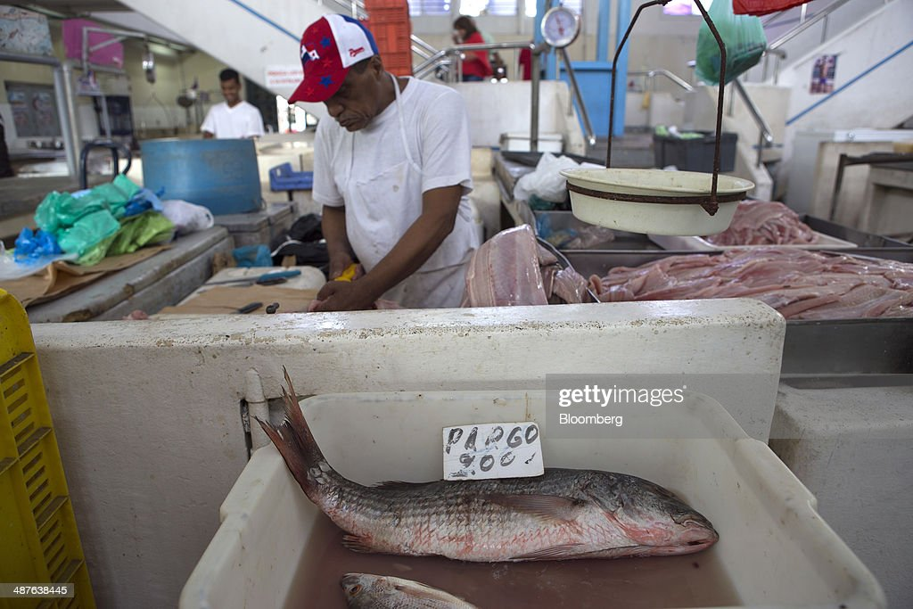 A fishmonger filets a fish at the local fish market in Panama City, Panama, on Wednesday, April 23, 2014. Panama has averaged about 9 percent economic growth annually since 2008 and unemployment levels hover near a record low of 4.1 percent. Photographer: Susana Gonzalez/Bloomberg via Getty Images
