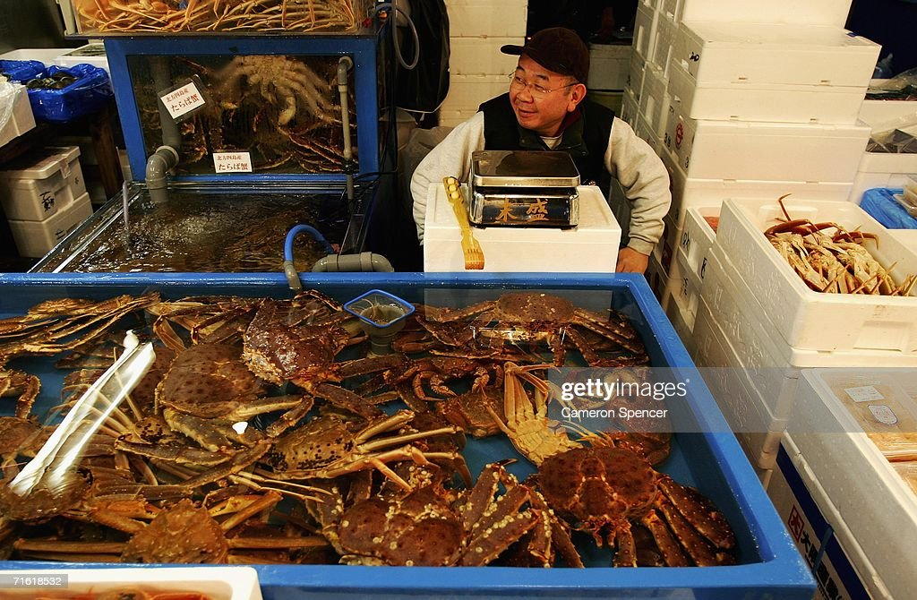 A fishmonger sits amongst crabs in his store at the Tsukiji Fish Market February 17, 2006 in Tokyo, Japan. Tsukiji Fish Market is Tokyo's central wholesale market where 2,500 tons of seafood is handled daily, making it one of the largest fish markets in the world. Licenced operators prepare and sell over 450 types of marine product in their wholesale stalls in the inner market (jonai shijo) to various caterers and retailers.
