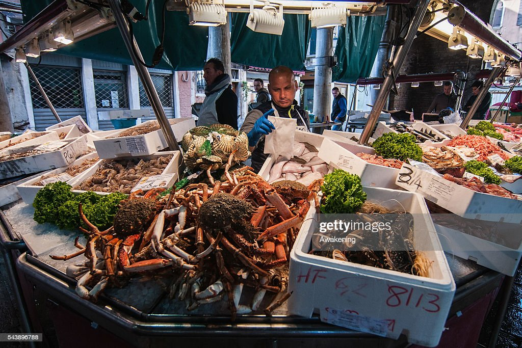 Fishmongers of the Venice Rialto Market prepare the fish on June 30, 2016 in Venice, Italy.