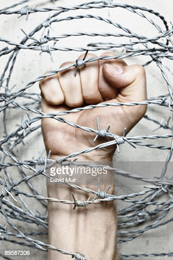 fist and barbwire