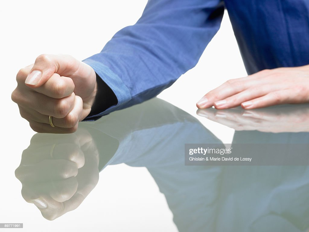 Fist of a woman on table