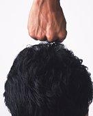 Fist over head of man