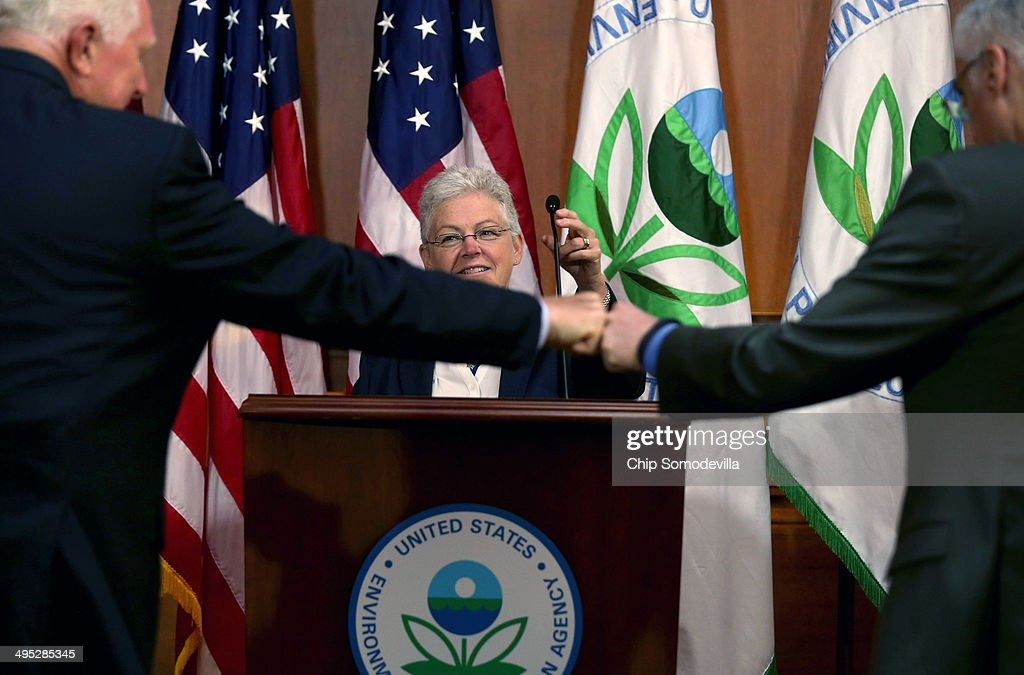 Fist-bumps were exchanged as U.S. Environmental Protection Agency Administrator <a gi-track='captionPersonalityLinkClicked' href=/galleries/search?phrase=Gina+McCarthy&family=editorial&specificpeople=7904226 ng-click='$event.stopPropagation()'>Gina McCarthy</a> arrives to announce new regulations for power plants June 2, 2014 in Washington, DC. Bypassing Congress and using President Barack Obama's 'Climate Action Plan,' the new regulations will force more than 600 existing coal-fired power plants, the single largest source of greenhouse gas emission in the country, to reduce their carbon pollution 30 percent from 2005 levels by 2030.