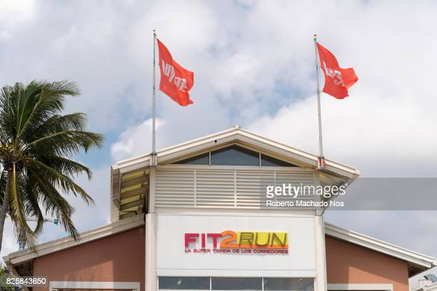 Fit 2 Run outlet Top part of athletic sportswear store with two flags on both sides of logo