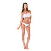 a2d523d0afd Studio portrait of a beautiful young brunette woman in a white bikini  isolated on white
