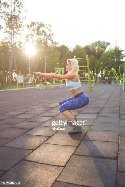 Fit caucasian woman doing lunges before workout in the park