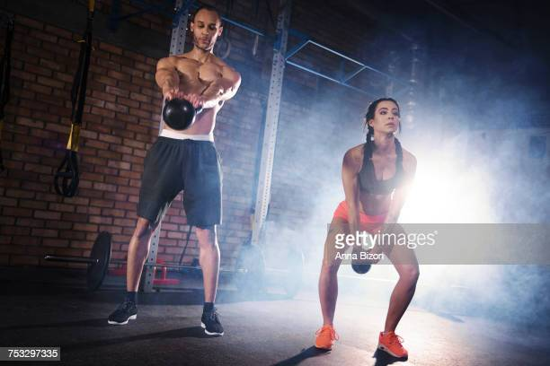 Fit couple practicing with kettlebell. Mielec, Poland