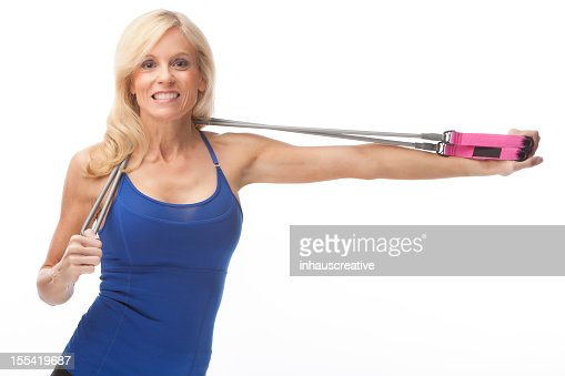 Fit Fifty Year Old Woman Working Out Stock Photo | Getty
