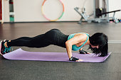 fit girl doing exercises on the floor in the gym.