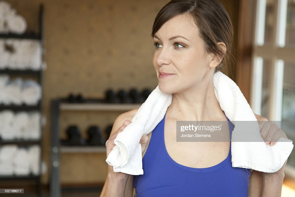 A fit, healthy woman weight lifting in a gym. : Stock Photo