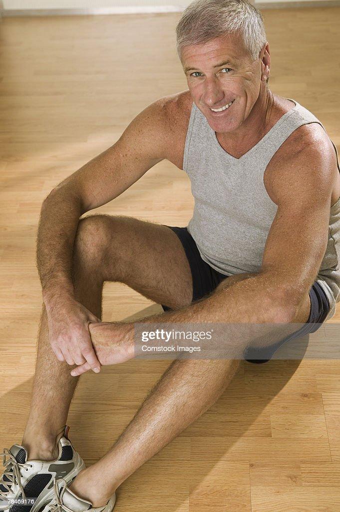 Fit man on floor : Stock Photo