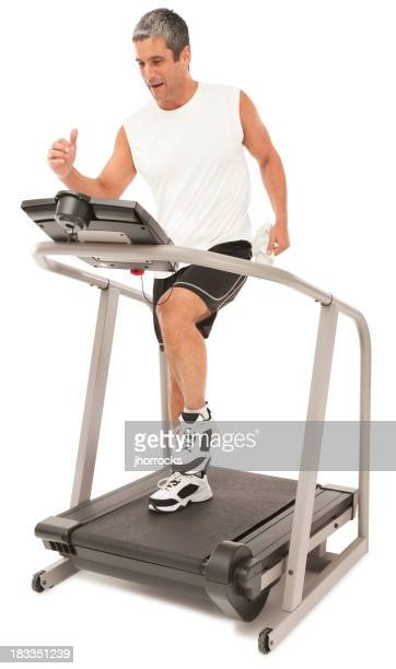 Fit Mature Man Running on Treadmill