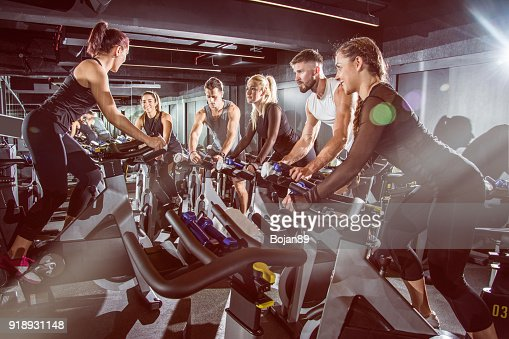 Fit people working out at exercising class in the gym. : Stock Photo