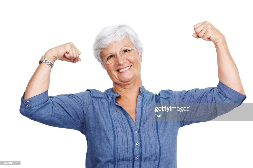 Fit senior female showing her biceps