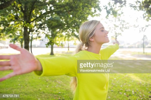 Fit smiling blonde enjoying the sun : Stock Photo