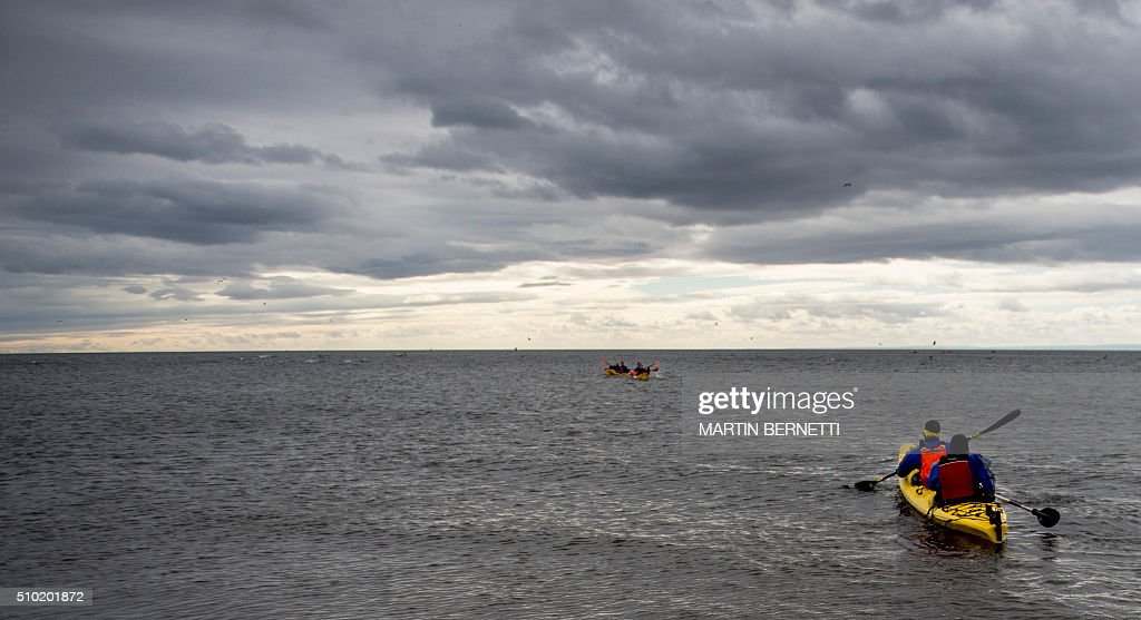 Fit team testing a kayak during practice before the Patagonian Expedition Race, in the southern Chilean Patagonian region near Punta Arenas, on February 14, 2016. Eighteen four-member teams from 12 different countries combine trekking, kayaking and mountain biking, covering hundreds of kilometers in this wilderness region, with a simple map and a compass. AFP PHOTO/MARTIN BERNETTI / AFP / MARTIN BERNETTI