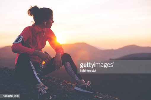 Fit woman athlete resting outdoors : Stock Photo