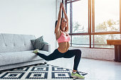 Fit woman doing front forward one leg step lunge exercises workout.