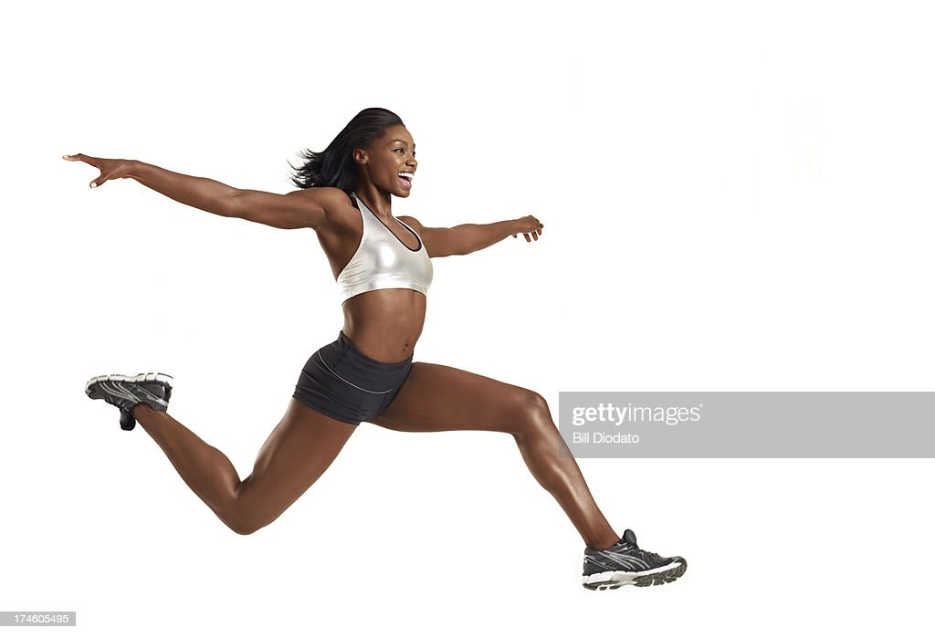 Fit woman leaping through the air : Stock Photo