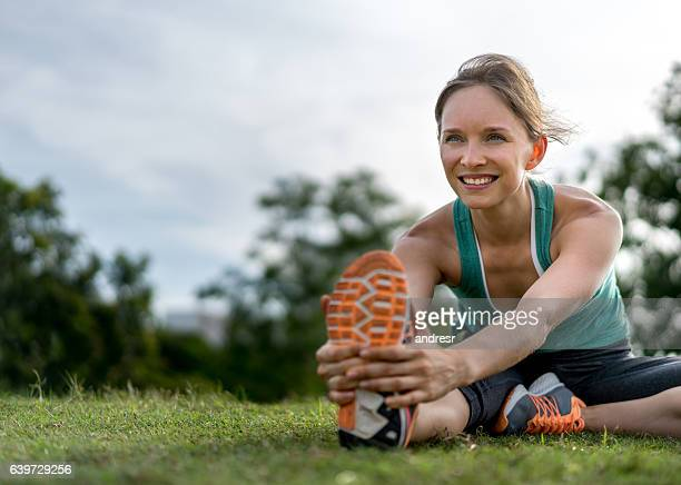Fit woman stretching at the park