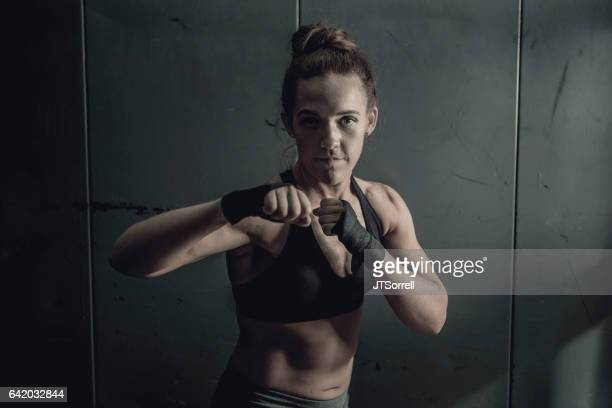 Fit Woman with Fists Raised