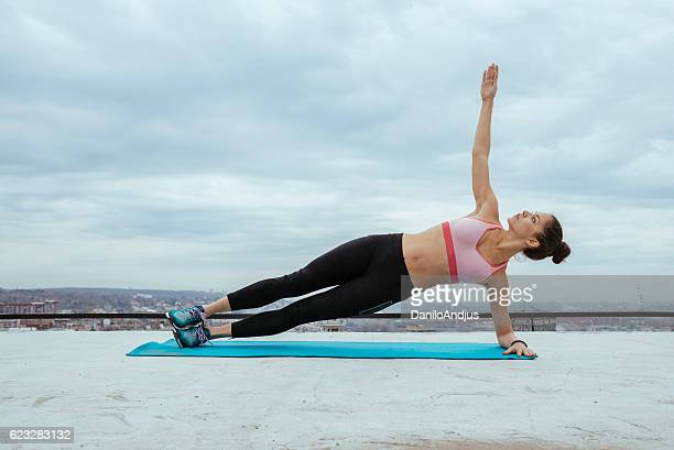 fit woman working out on the rooftop
