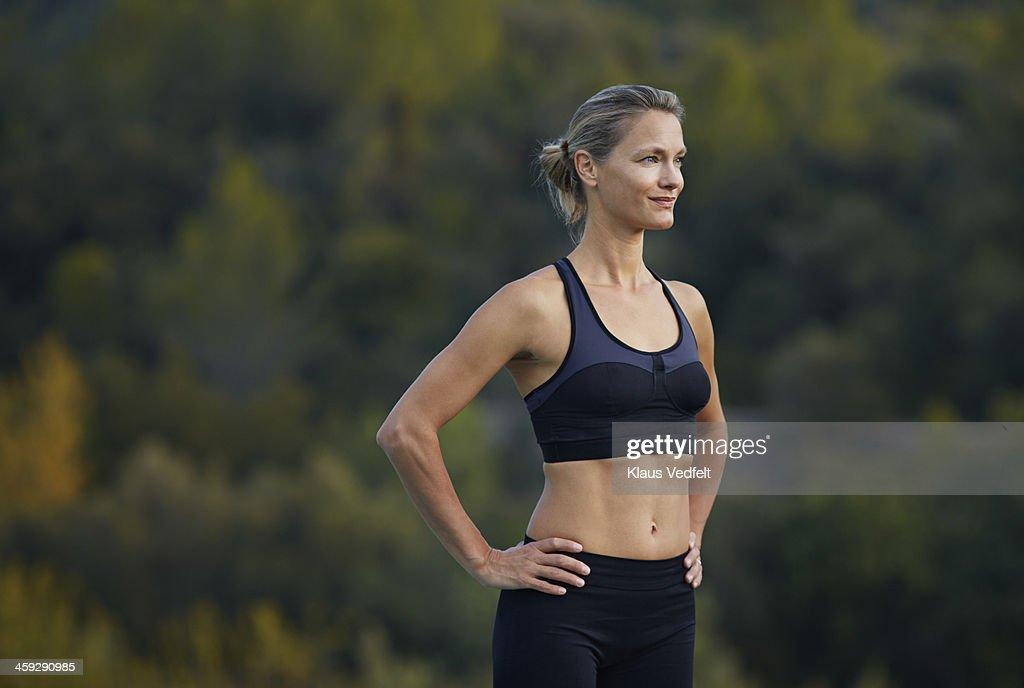 Fit yoga teacher standing confident & smiling