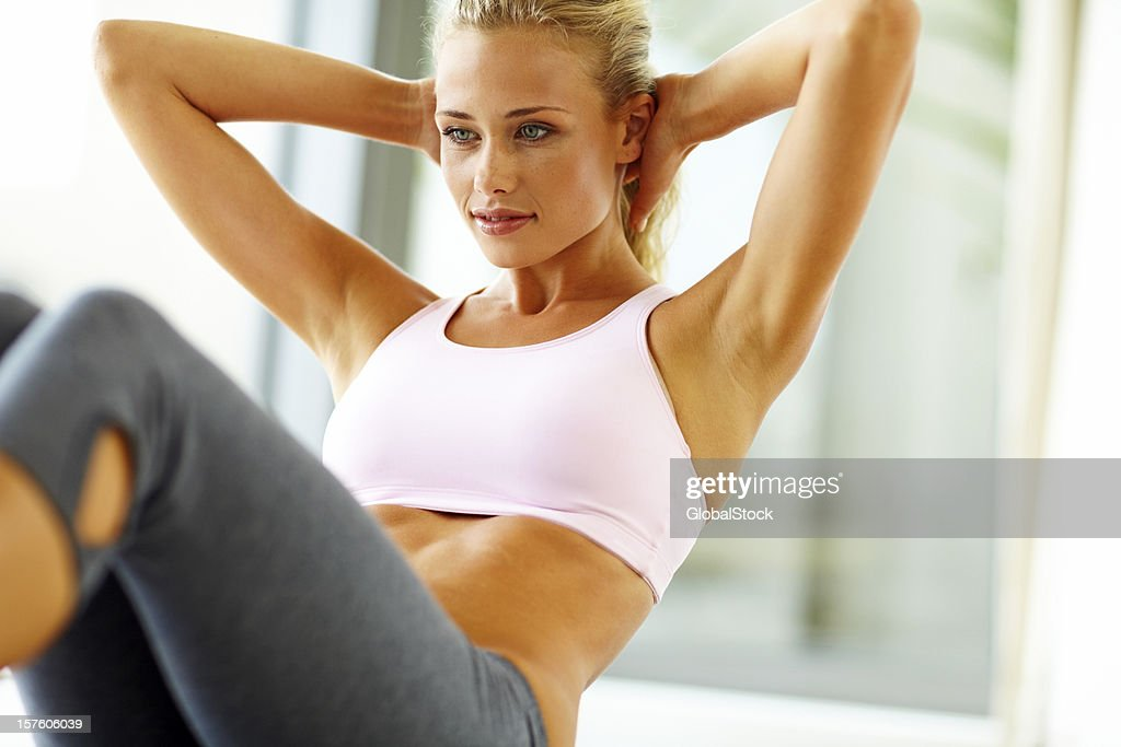 Fit young lady doing crunches : Stock Photo