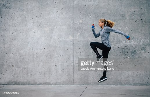 Fit young woman doing cardio interval training : Stock Photo