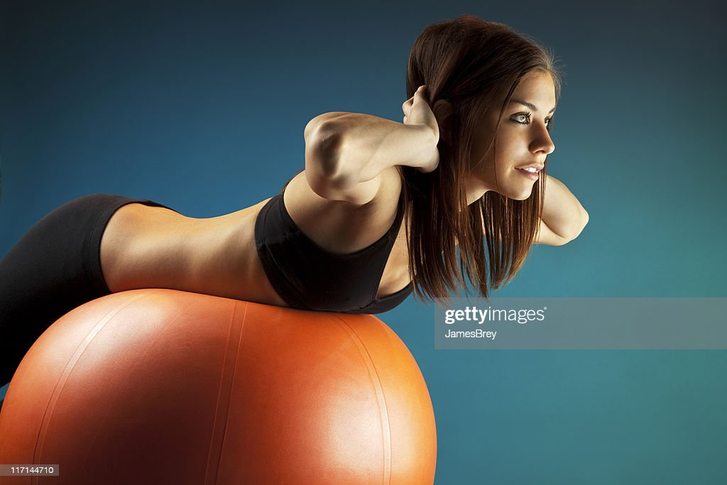Fit Young Woman Training on Exercise Ball : Stock Photo