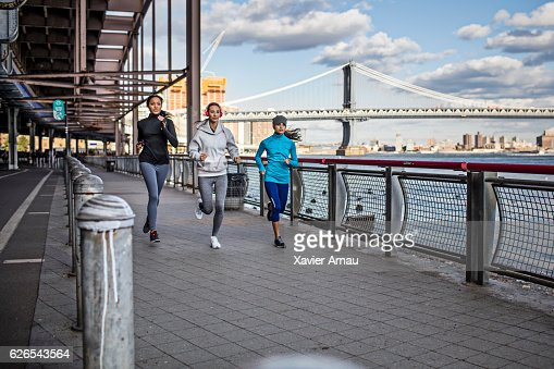 Fit young women running on promenade