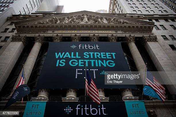 Fitbit banners decorate the exterior of the New York Stock Exchange during the IPO debut of the company on June 18 2015 in New York City According to...