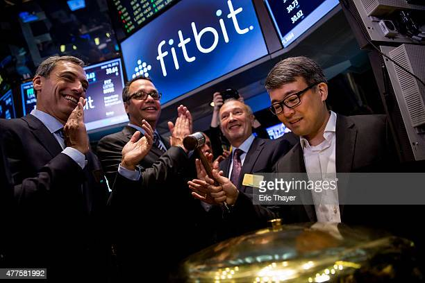 Fitbit Chief Executive James Park rings a ceremonial bell for the company's IPO debut on the floor of the New York Stock Exchange on June 18 2015 in...