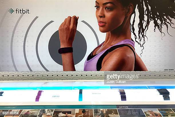 Fitbit fitness trackers are displayed on a shelf at a Target store on January 30 2017 in Los Angeles California Fitbit announced that it will lay off...