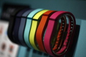 Fitbit Flex wearable electronic fitness devices sit on display at the Fitbit Inc pavilion on day two of the Mobile World Congress in Barcelona Spain...