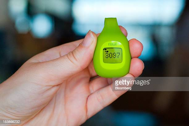 A Fitbit Inc wearable fitness device is displayed for a photograph in San Francisco California US on Tuesday Oct 9 2012 Fitbit's target audience is...