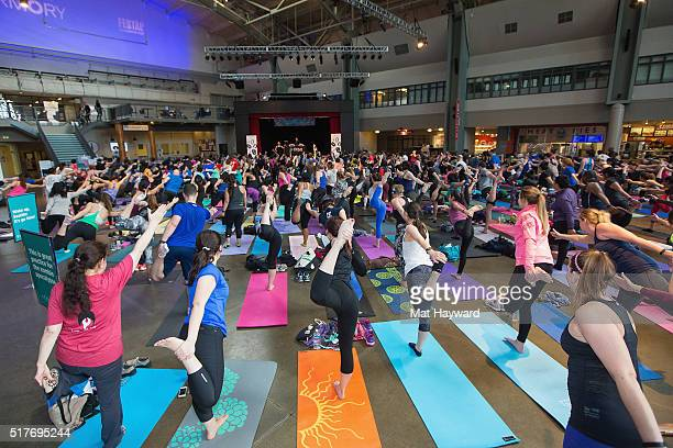 Fitbit Local Ambassadors Kaisa Keranen Kevin Ng lead participants in a bootcamp and yoga workout as Fitbit Local Seattle launches with a free event...